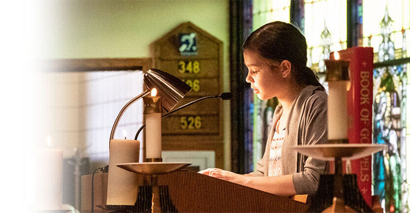 Girl student reading at mass