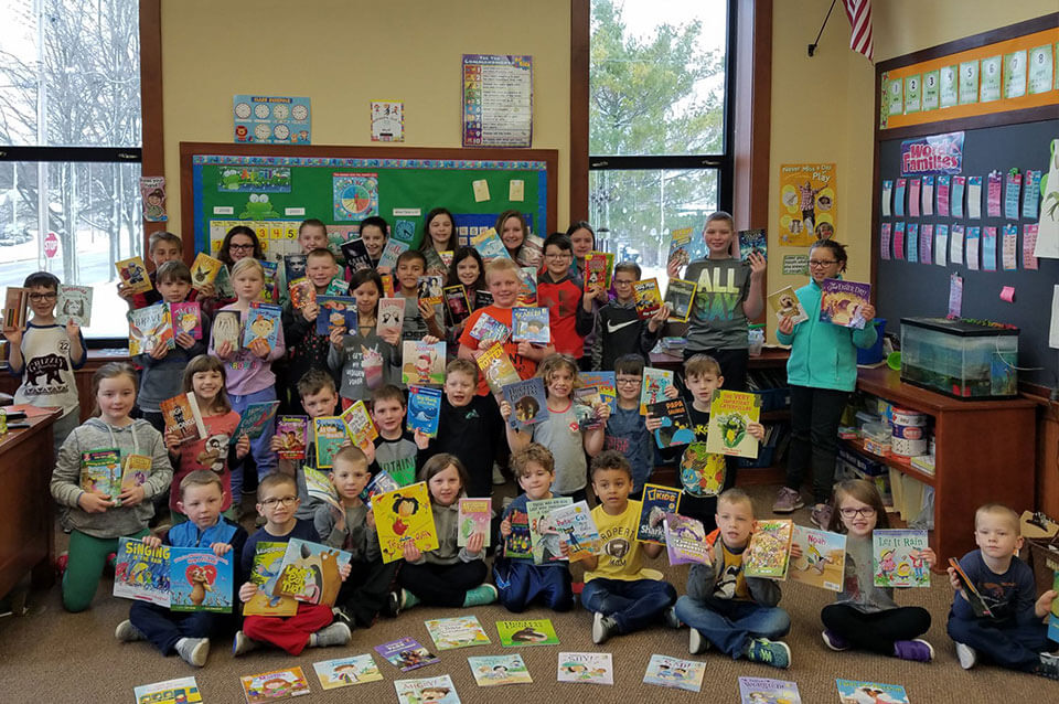 Group photograph of all students posing with their Scholastic Book fair books