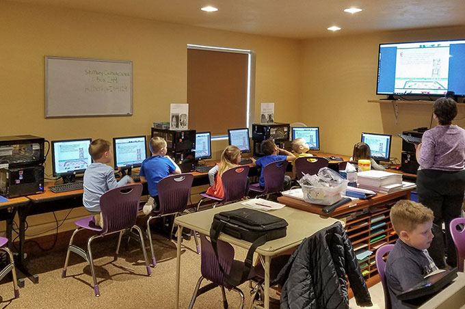 Students attending a computer education class in the tech room