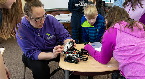 Third and Fourth grade classes building robots